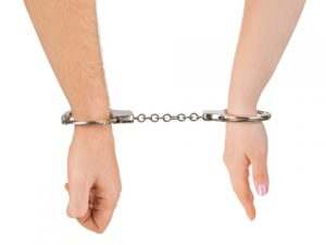 Man and woman hands and handcuffs isolated on white background